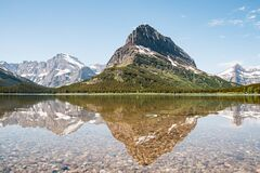 Free A Snowy Mountain Water Reflection On Swiftcurrent Lake In Many Glacier Region Of Glacier National Park, Montana. Grinnell Point, A Royalty Free Stock Photography - 179204847