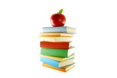 A Stack Of Color Books And Apple Stock Photography