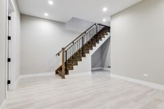 Free A Staircase Leading Into An Empty Finished Basement Room. Stock Photo - 195512910