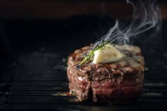 Free A Steaming Beef Tenderloin Steak Is Grilled Stock Images - 198336184