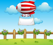 Free A Stripe Blimp Carrying An Empty Banner Stock Photography - 32710052