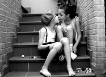 A Sweet Kiss Between Two Children Royalty Free Stock Image
