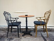 Free A Table With 2 Chairs Next To A Wall. Street Cafe In The Center Of Bucharest City Stock Images - 199160704