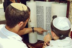 Free A Teacher And A Young Man Fingers Pointing At A Phrase In A Bible Book, While Reading A Pray At A Jewish Ritual Stock Images - 116998694