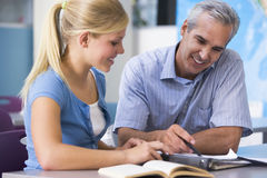 Free A Teacher Instructs A Schoolgirl Stock Images - 6082174