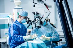 Free A Team Of Surgeons Performing Brain Surgery To Remove A Tumor. Stock Image - 194884491