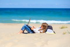 Free A Teen Girl Lies On The Beach With A Laptop Stock Image - 156471411