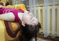 Free A Teenage Girl At Home On The Sofa With Her Eyes Closed Is Lying Upside Down Royalty Free Stock Photo - 178687825