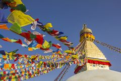 Free A Tibetan Buddhist Stupa Bodhnath With Eyes And Multicolored Prayer Flags Against A Clean Blue Sky At Daytime Royalty Free Stock Photography - 135761237