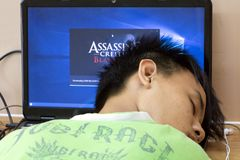 Free A Tired Game Player Sleep On A Computer Keyboard. Royalty Free Stock Photography - 156153407