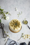 A Top-view Of A Round Cake On The Cakestand Decorated With Almonds And Ground Rosemary Royalty Free Stock Images