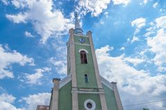 Free A Tower Of A Green Church With A Blue Sky Above Stock Images - 114260434