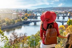 A Traveler Woman With Red Hat Enjoys The Elevated View Over The City Of Prague, Czech Republic Stock Photography