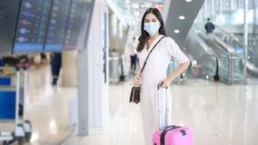 Free A Traveller Woman Is Wearing Protective Mask In International Airport, Travel Under Covid-19 Pandemic, Safety Travels, Social Stock Photos - 193559993