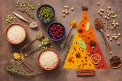 Free A Variety Of Spices, Cereals, Beans, Seeds On A Dark Background. Abstract Christmas Tree. Top View Stock Images - 161180314