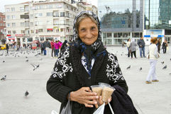 A Very Old Turkish Woman Selling Birdseeds Stock Photos