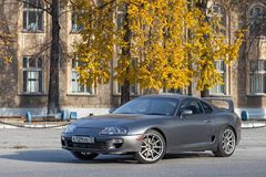 Free A Very Rare Japanese Sports Car In The Back Of A Toyota Supra Coupe In Gray With A High Spoiler On The Road In The City Near Trees Stock Photo - 160693610