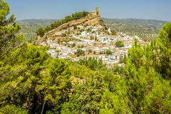 Free A View Through The Trees Of The Hilltop Church Above The Town Of Montefrio, Spain Royalty Free Stock Image - 193054236