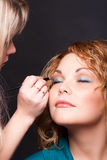 A Visagiste Inflicts A Make-up To The Woman Stock Image
