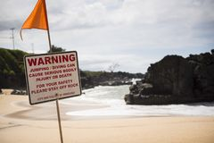 A Warning Sign At The Beach Stock Images