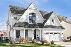 Free A White Modern Farmhouse With A Black Roof. Royalty Free Stock Image - 210692496