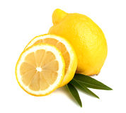 A Whole Lemon Slices On Leaves Stock Photos