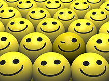 A Winking Smiley In A Crowd Of Happy Smileys Stock Image