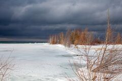 Free A Winter Storm Approaches The Shores Of Southern Georgian Bay In Lighthouse Point, Collingwood Royalty Free Stock Photos - 211309788