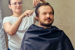 Free A Woman Cuts A Man`s Hair With Scissors, Close-up. The Concept Of Closed Salons And Barbershop During The Isolation Of Coronaviru Royalty Free Stock Image - 198978026