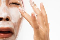Free A Woman Is Washing Face And Foam Into The Eyes Royalty Free Stock Image - 126188506