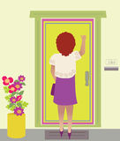 A Woman Knocking On The Door Stock Images