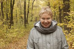 Free A Woman Of Mature Age In The Forest With Yellow Leaves Royalty Free Stock Photo - 129850425