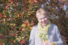 Free A Woman Of Mature Age With A Yellow-green Scarf Around Her Neck Stock Images - 128903154
