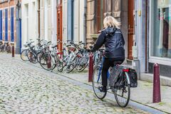 Free A Woman Riding Bike On Stone Made City Road Royalty Free Stock Photos - 175343808