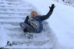 Free A Woman Slipped And Fell On A Wintry Staircase Royalty Free Stock Photography - 130710257