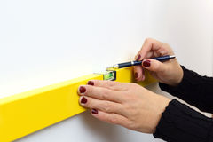 A Woman Using A Spirit Level For Home Work Stock Photos