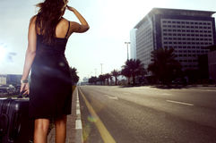 A Woman Walking On The Side Of A Road Royalty Free Stock Image
