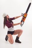 A Woman With An Electric Saw In Her Hand Royalty Free Stock Images