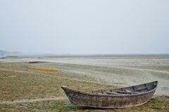 Free A Wooden Boat On The Bank Of The Dry River At Dhaka, Bangladesh Stock Image - 208471831