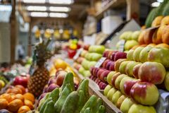 Free A Wooden Counter With A Variety Of Ripe Fruit On The Market. Healthy Nutrition, Vitamins And Vegetarianism Stock Photos - 183600913