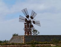A Wooden Wind Mill With Six Wings Stock Photos