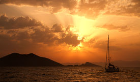 A Yacht At The Sea During A Sunset Stock Photography