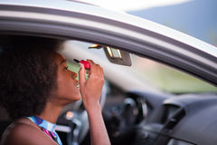 Free A Young African-American Woman Makeup In The Car Stock Photography - 78820322