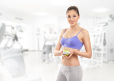 A Young And Fit Brunette Woman Holding An Apple Stock Image
