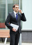 A Young And Handsome Businessman On The Phone Royalty Free Stock Images