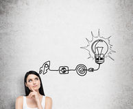 Free A Young Brunette Lady Is Thinking About The Process Of Developing A New Idea. A Flowchart Is Drawn On The Concrete Wall With Diffe Royalty Free Stock Photo - 62673775