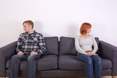 A Young Couple On A Sofa Royalty Free Stock Images