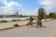 Free A Young Couple Riding Bicycles On The Danube Island. Vienna, Austria Royalty Free Stock Photography - 106925517