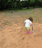 A Young Girl Learning To Play Golf