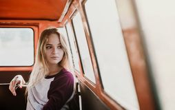 Free A Young Girl Sitting In A Car On A Roadtrip Through Countryside. Royalty Free Stock Photography - 147452107